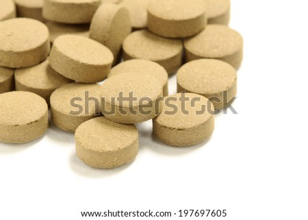 Bitter tablets isolated on white background