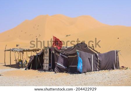 Bivouac in desert - stock photo