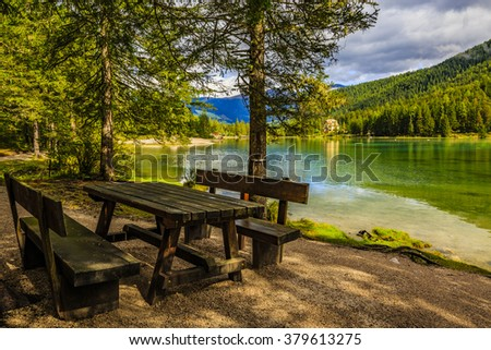 Bivouac resting place by the Toblacher Lake in Italian Alps. - stock photo