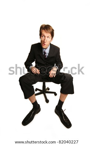 bizarre businessman making faces isolated on white