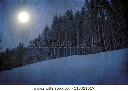 Bizarre dark winter landscape in blue colors with moonlight - stock photo