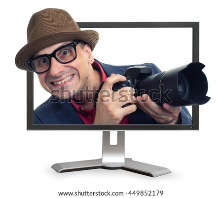 bizarre man with camera looks out from monitor. Isolated on white - stock photo