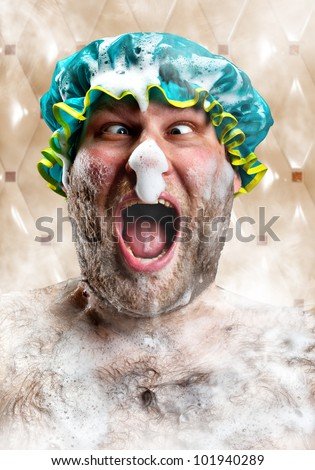 Bizarre man with soap foam on nose taking bath - stock photo