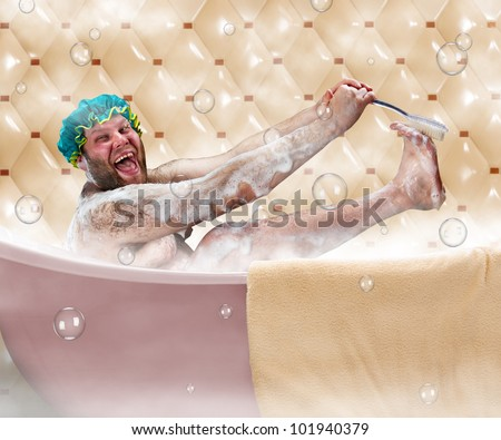 Bizarre ugly man washing his leg in a bath - stock photo