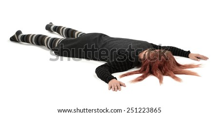 Bizarre woman lying on the floor  - stock photo