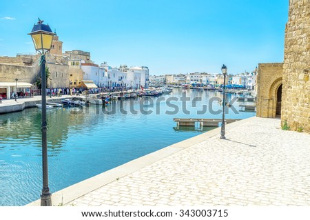BIZERTE, TUNISIA - SEPTEMBET 4, 2015: The old port is empty in the middle of the hot day on September 4 in Bizerte.