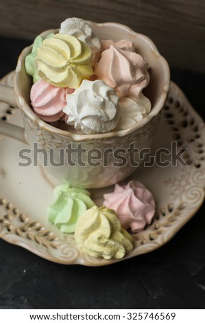 Bizet or meringues cookies on the vintage or rustic kitchenware