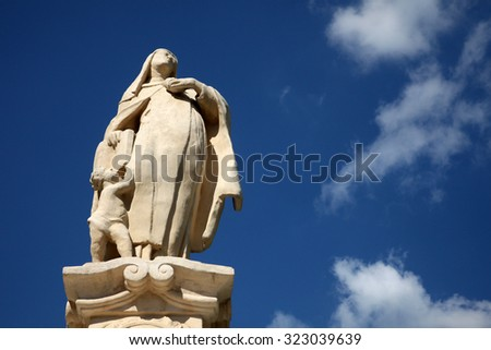 BJELOVAR, CROATIA - SEPTEMBER 06: Saint Teresa of Avila statue in front of the Cathedral of St. Teresa of Avila in Bjelovar, Croatia on September 06, 2013 - stock photo