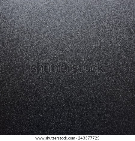 Black Abstract Textured Background with Spotlight - stock photo