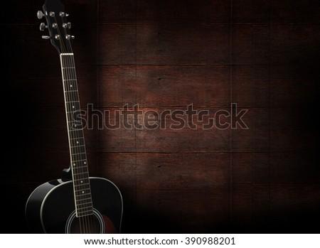 Black Acoustic Guitar On Dark Red Wooden Background