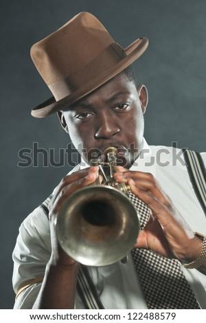 Black african american jazz trumpet player. Vintage. Studio shot. - stock photo
