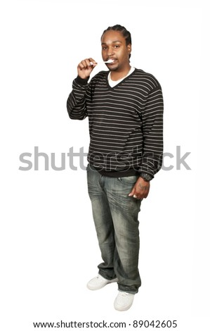 Black African American man practicing good oral dental care by brushing his teeth