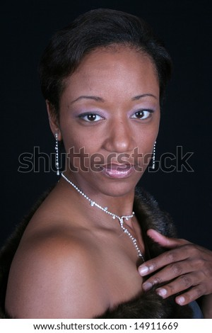 Black African American mature woman  with a bare shoulder - stock photo