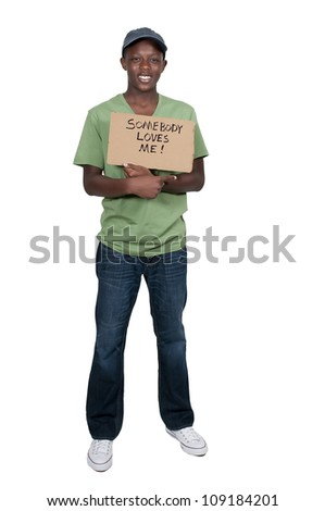 Black African American teenager holding up a sign that says Somebody Loves Me - stock photo