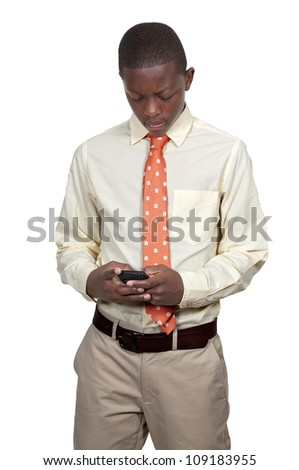 Black African American teenager man using a cell phone for texting - stock photo
