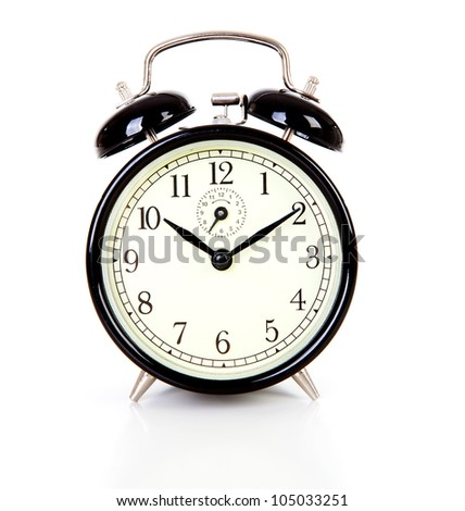 Black alarm clock over white background