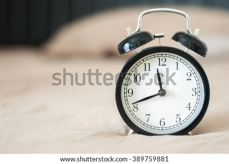 black alarm clock with background soft