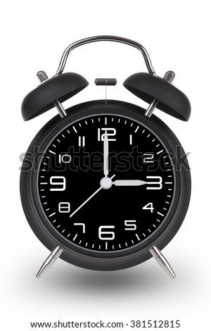 Black alarm clock with the hands at 3 am or pm isolated on a white background. - stock photo