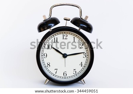Black alarm clock with white isolated background.