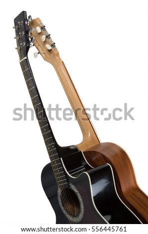 Black and beige guitar isolated on white background.