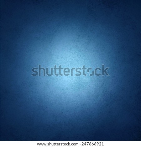 black and blue background with white center spotlight and faint texture - stock photo