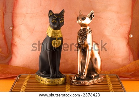 Black and bronze cats - stock photo