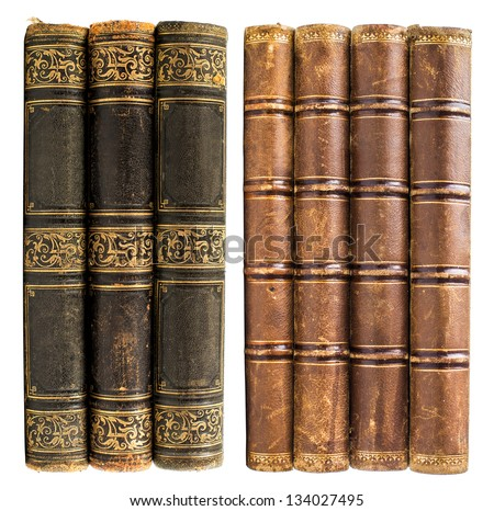 black and brown old books with golden design isolated on white - stock photo