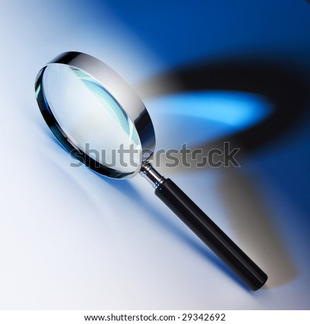 Black and chrome magnifying glass - stock photo