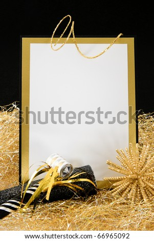 Black and Gold Blank Invitation or Sign with Copy-Space accented with Party Favors - stock photo