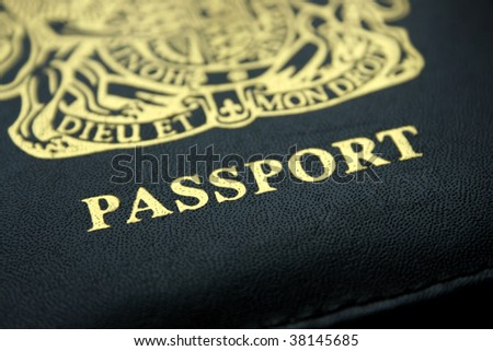Black and gold lettered British passport cover - stock photo