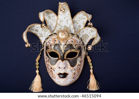 black and gold mask isolated on a black background