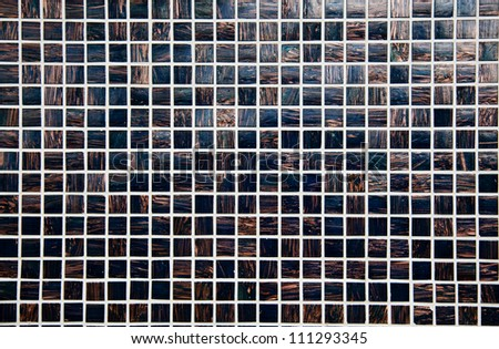 Black and gold mosaic tile background - stock photo