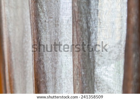 Black and gray tulle background with drapery background - stock photo