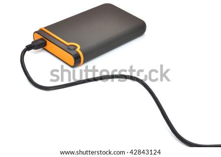 Black and orange portable storage disk, isolated on white - stock photo