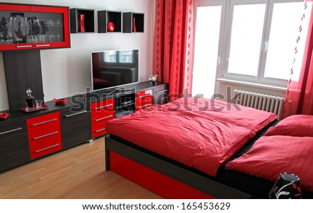 Black and red bedroom - stock photo