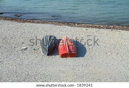 Black and red boats on the beach - stock photo