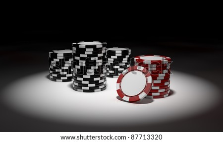 black and red gambling chips in spotlight