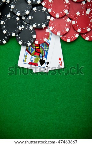 Black and red poker chips in the background. - stock photo
