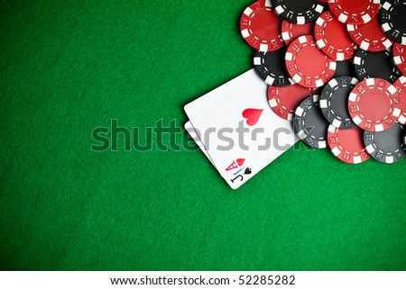 Black and red poker chips in the background - stock photo