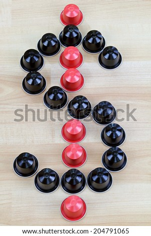 Black and Red single-serve coffee capsules in a shape of Dollar Sign - stock photo