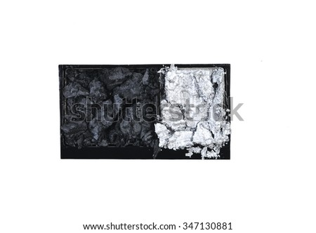 black and silver scattered in box eye shadows isolated on white background