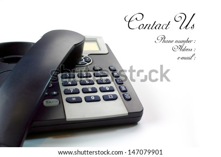 Black and silver telephone on white - stock photo