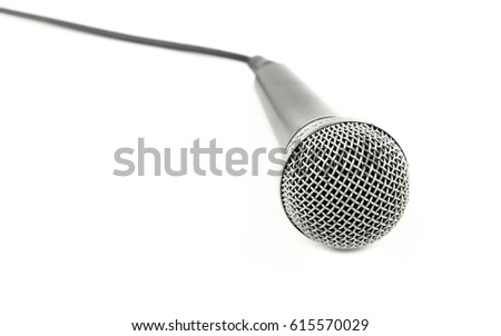 Black and silver vocal microphone with cable high angle view close up isolated on white background, personal perspective