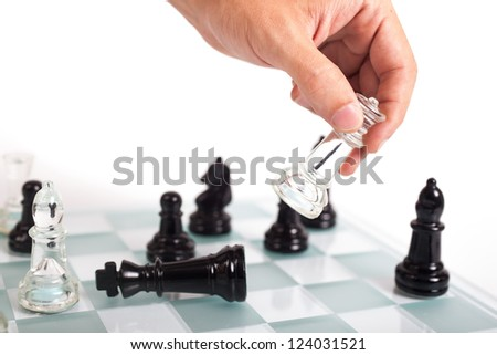 Black and transparent glass chess pieces, on a see through chessboard. Checkmate. - stock photo