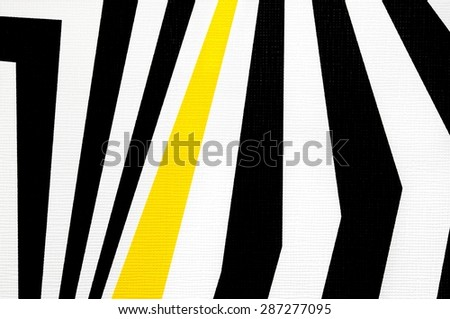 black and white abstract regular geometric fabric texture background, with yellow line  - stock photo