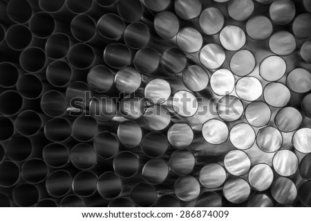 Black and white abstract shot of backlit drinking straws. - stock photo