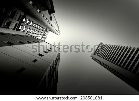 Black and white abstract upward view of downtown skyscrapers. - stock photo