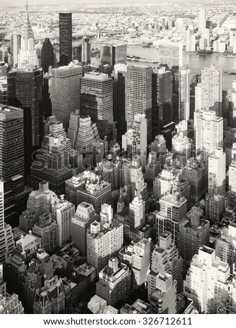 Black and white aerial view of skyscrapers at midtown New York City - stock photo