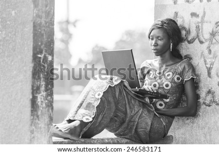 Black And White: African Business Woman Working on Computer Laptop - stock photo