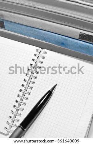 Black and white aged books with notebook, pen and blue book. - stock photo